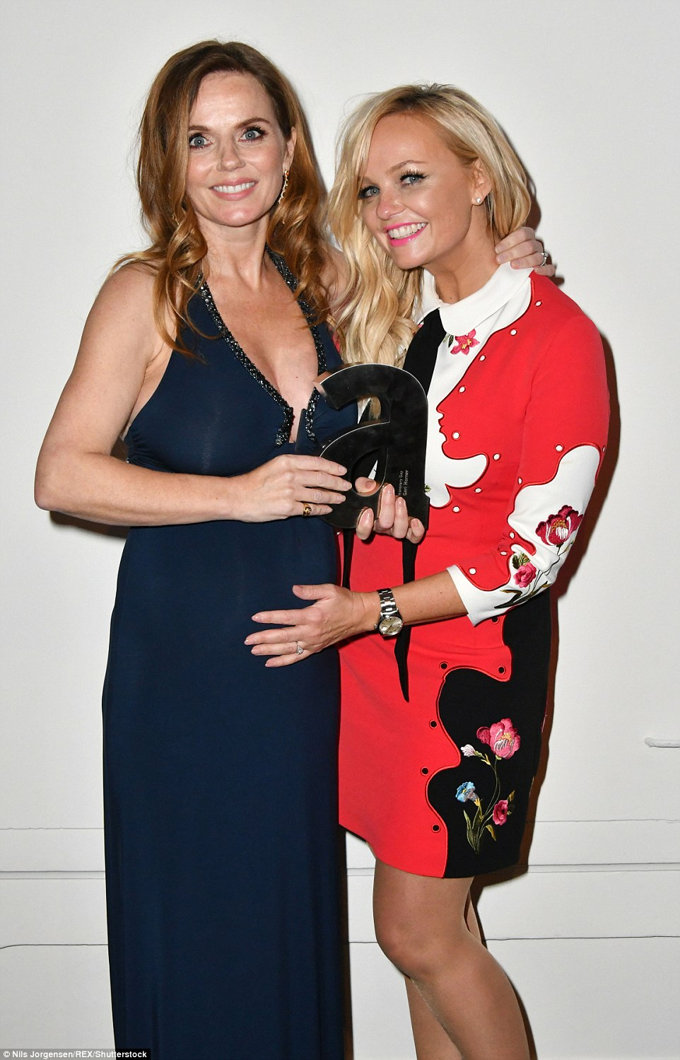 Smiles all around: Emma could not look happier for her friend as she held on tight to her baby bump