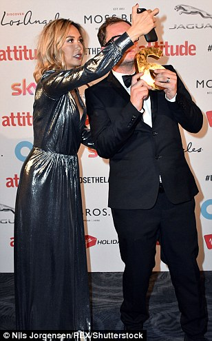 Say cheese! Alan Carr, winner of the Icon Award for Outstanding Achievement, played around with Myleene Klass on the carpet as the fun-loving pair took selfies together