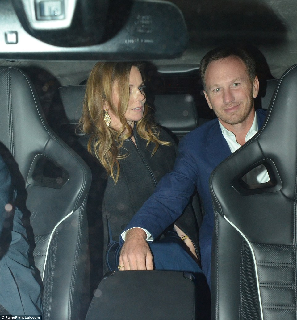 Heading home: Formula 1 boss Christian placed a protective hand on his pregnant partner's knee