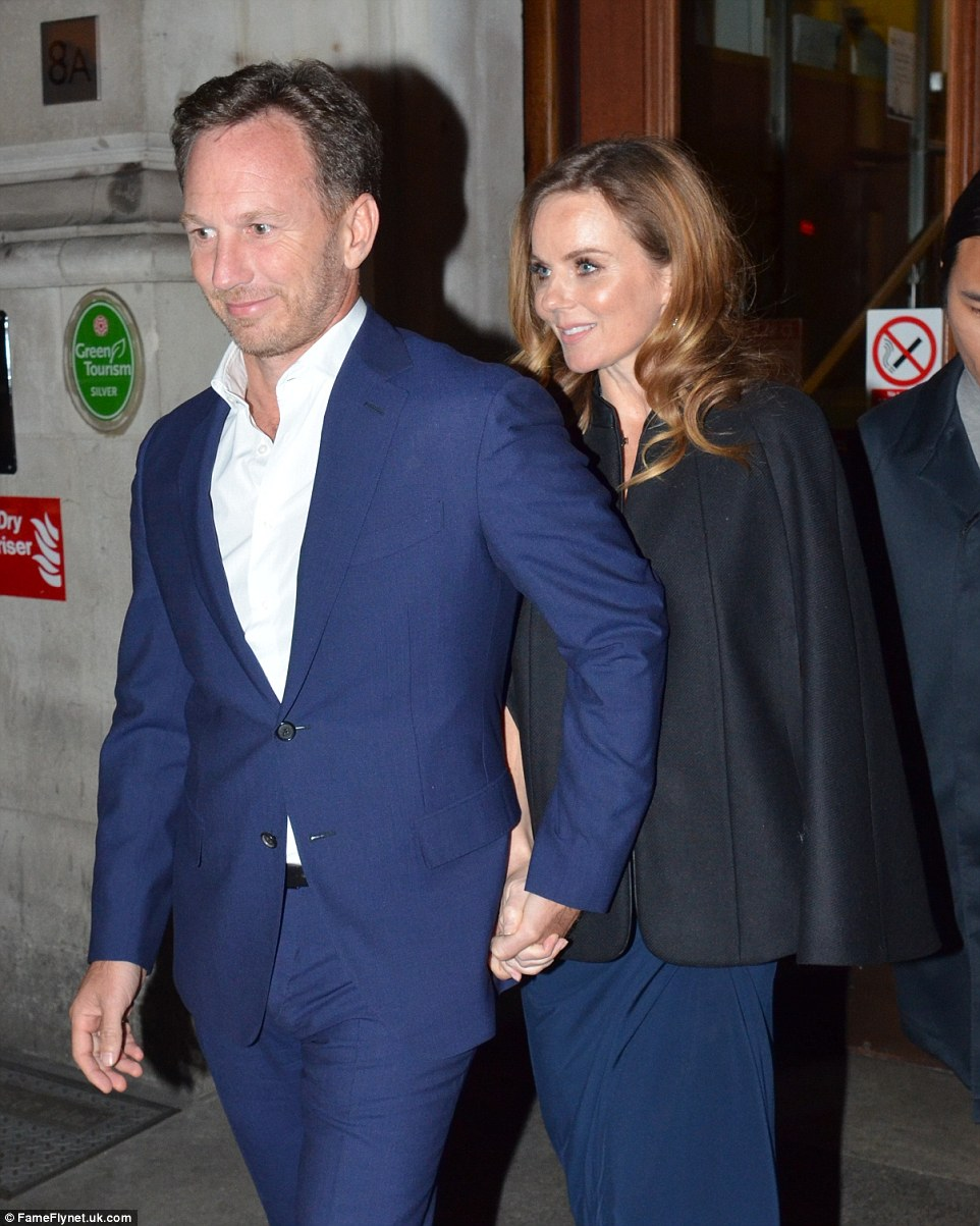 Picture of happiness: The former Spice Girl looked positively radiant as she headed home for the evening