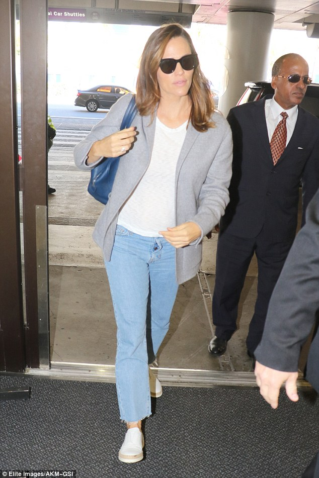Relaxed: Jennifer Garner jetted out of LAX on Monday ahead of speaking at Hillary Clinton's rally in Nevada