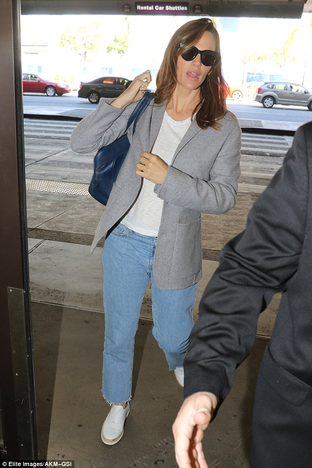 Stylish: The 44-year-old actress took a leaf out of Hillary's closet, choosing to wear trousers and a blazer jacket