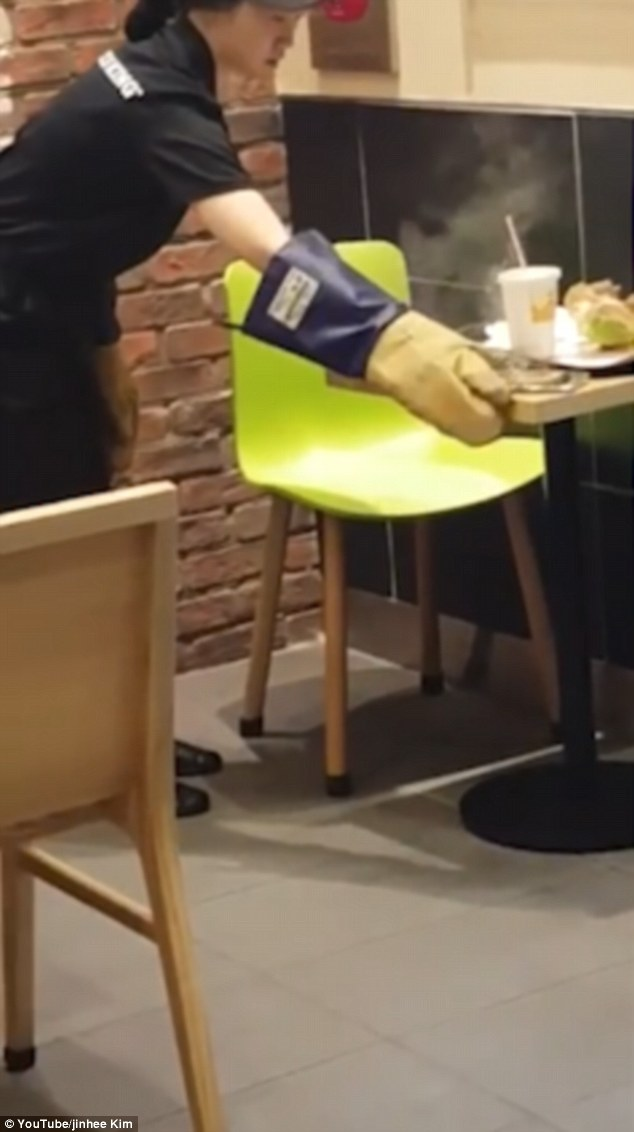The restaurant inIncheon in South Korea has said it is seeking compensation for the damage to the burnt table