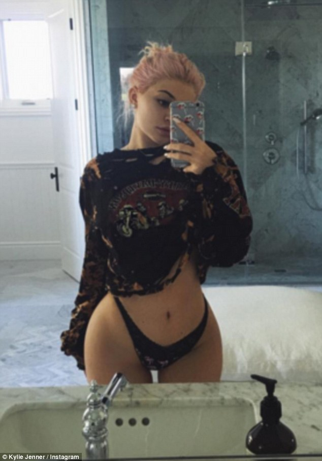 Fighting back: Kylie Jenner, 19, hit back at a Twitter troll after they said she 'looks like a 14-year-old prostitute' in response to a saucy selfie shared by the star