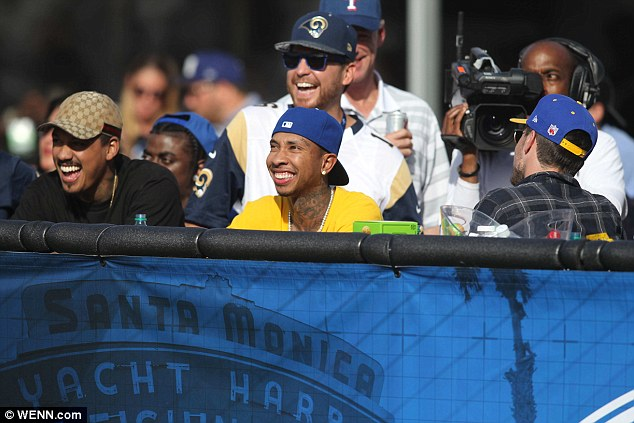 Time with his boys: Meanwhile Kylie's boyfriend Tyga was seen watched the Los Angeles Rams play the Buffalo Bulls that same day