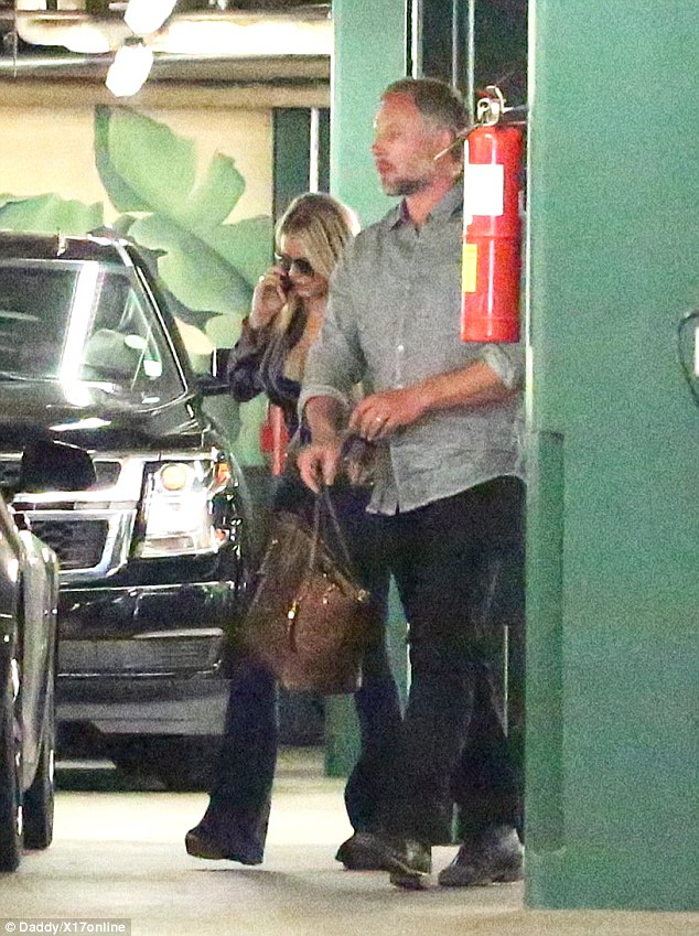 Out and about: Jessica Simpson, 36, was clad in loose-fitting bell bottoms while out in Beverly Hills on Monday with husband Eric Johnson, 37, amid recent reports her friends think she's expecting her third child