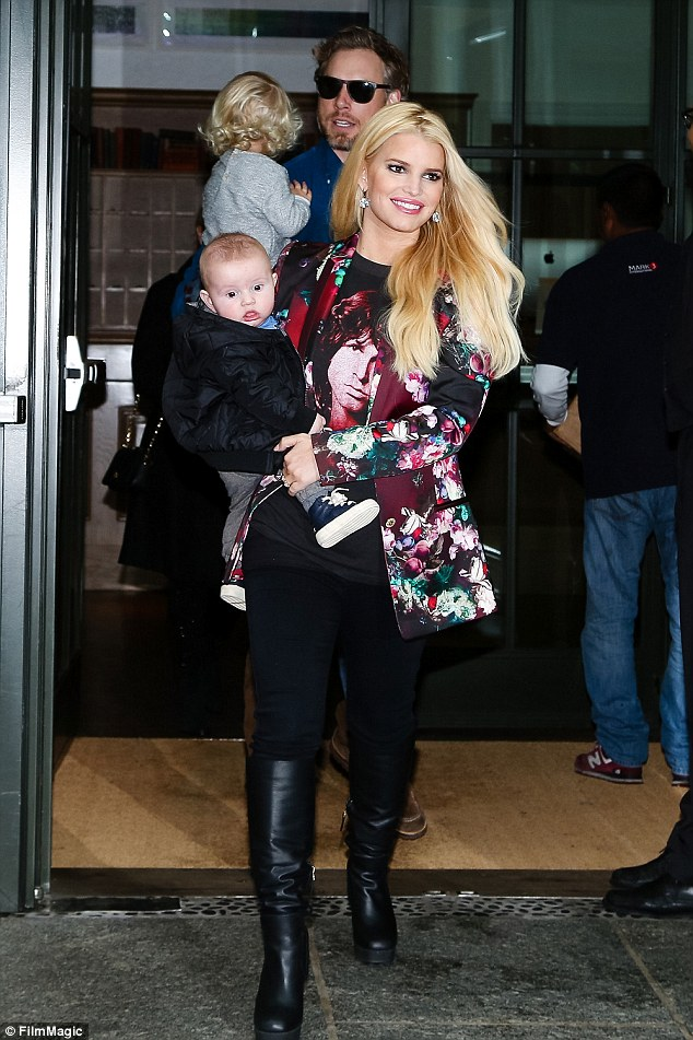 Happy and healthy: Johnson and Simpson have proven to be responsible and attentive parents amid their first five years of having a family. The group was pictured in NYC in December 2013