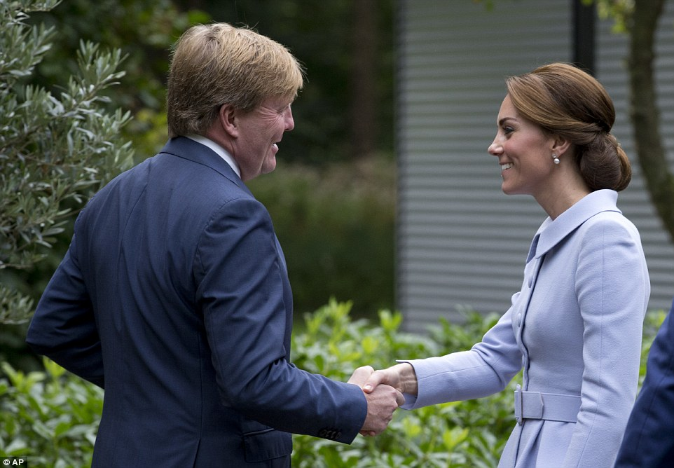Kate, 34, looked elegant in a pale blue skirt suit by Catherine Walker as she made a courtesy call to King Willem-Alexander at Villa Eikenhorst this morning