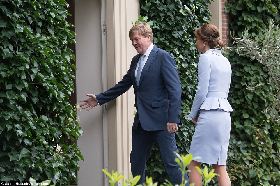 King Willem Alexander shows Kate into the Villa Eikenhorst on the forested De Horsten estate in Wassenaar, near The Hague where the pair will have lunch together