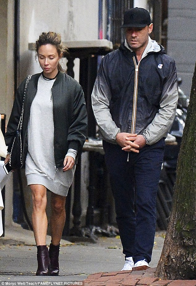 Toned pins: The unknown woman flaunted her lean legs in an oversized grey sweatshirt