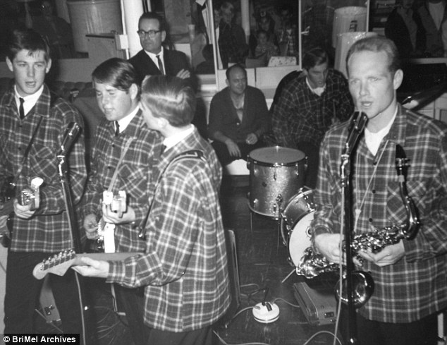 Brian gave up his baseball dreams to pursue music. One of the earliest local gigs for the band was playing at Leonard¿s Department store. His father is in the background overseeing their performance