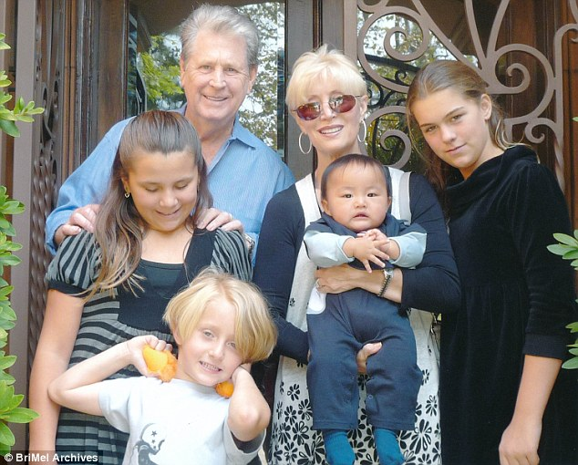 Wilson's life is now back on track. He and Ledbetter now live in a house in Beverly Hills, California, with their five children (four pictured above in 2009), who are all adopted