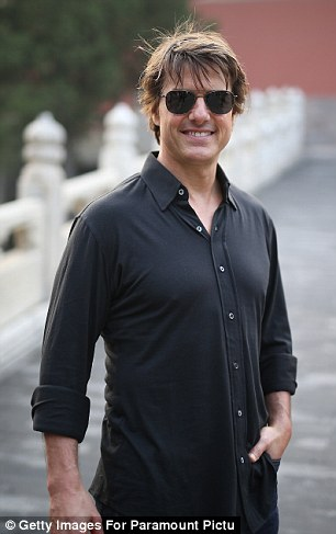 A-list: Tom looked in find spirits as he visited the Forbidden City