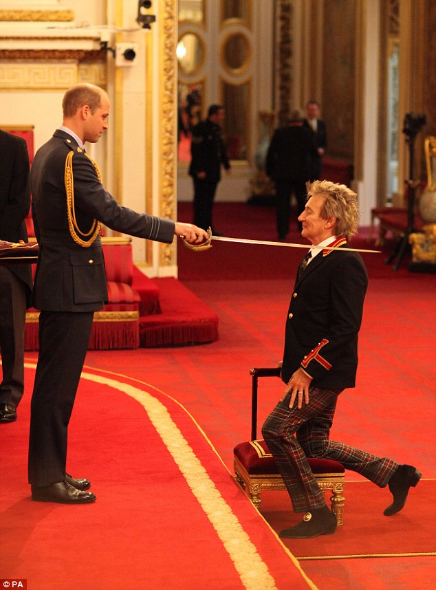 Arise! Rod Stewart knelt before Pince William while receiving his Knighthood for services to music and charity on Tuesday morning