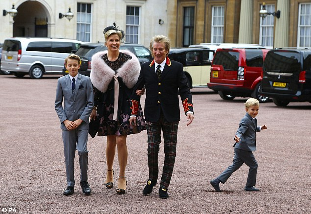 Suited and booted: Alistair, ten, and five-year old Aiden were dressed for the occasion