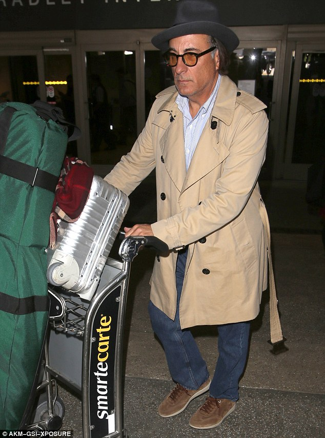 Sincere: Andy looked arrived at the Tom Bradley International Terminal at LAX