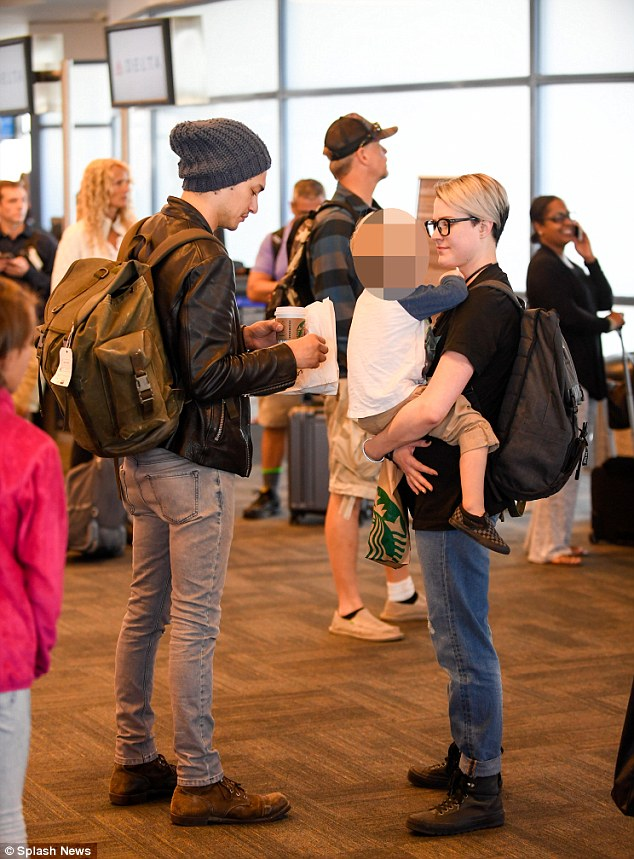 Family outing: Evan Rachel Wood looked the picture of happiness as she jetted out of LAX on Tuesday, cradling her young son in her arms