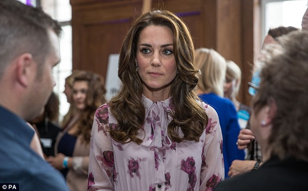 Kate listens during a conversation about 'mental health first aid' at a reception at County Hall