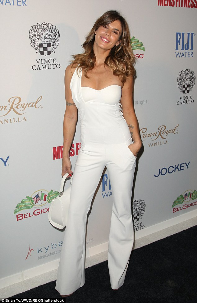 Heavenly!Elisabetta Canalis wore a stunning all-white ensemble with a matching purse and slick of lip gloss to top off her cosmetics