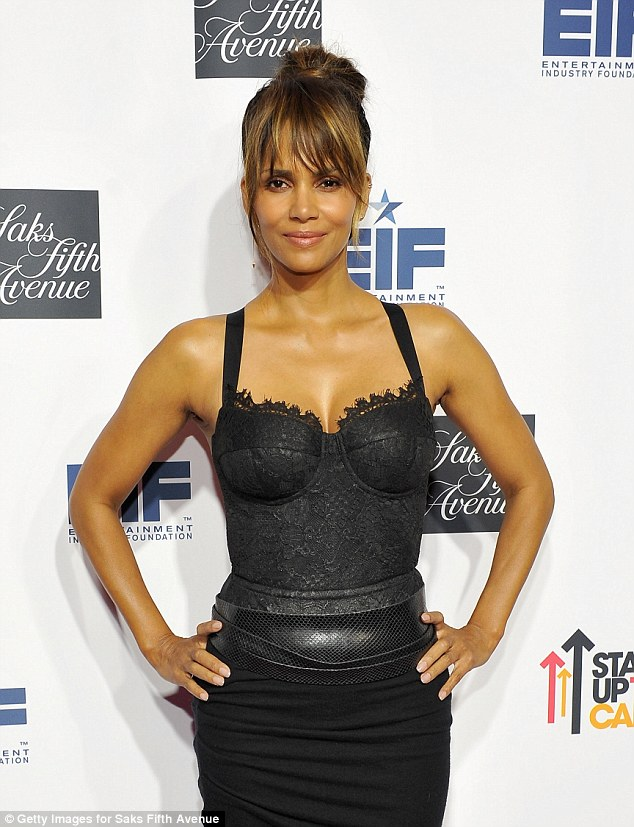 Toned and terrific!Cinched at the waist, the number highlighted Halle's incredibly gym-honed physique and was teamed with a pair of pointed black heels