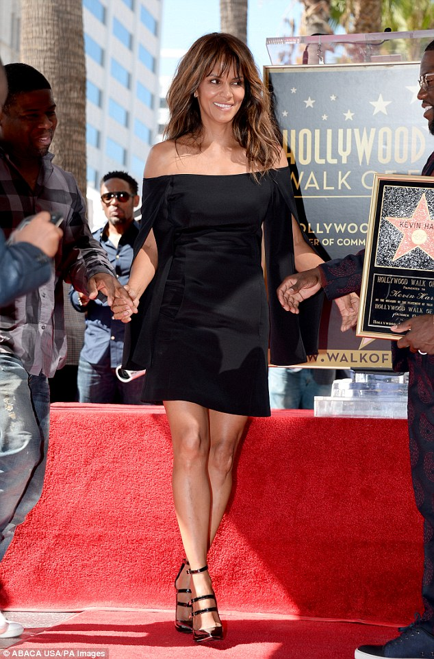 Looking good! The 50-year-oldsupported her friend Kevin Hart, right, as he received a star on the Hollywood Walk Of Fame in a sophisticated black dress earlier that day