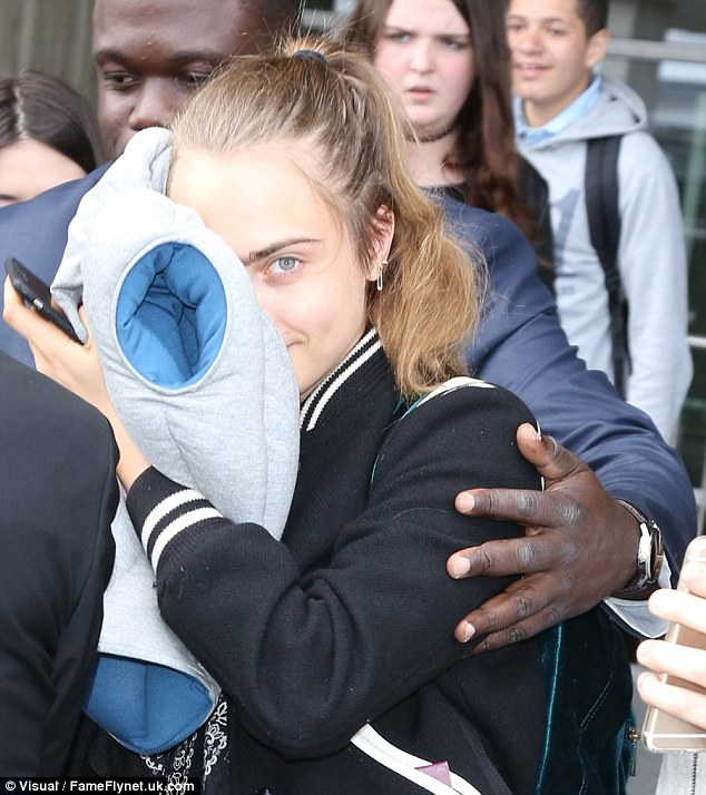 Cara Delevingne is a fan of her Ostrich pillow, a cushy helmet which is worn over the head for comfort and privacy