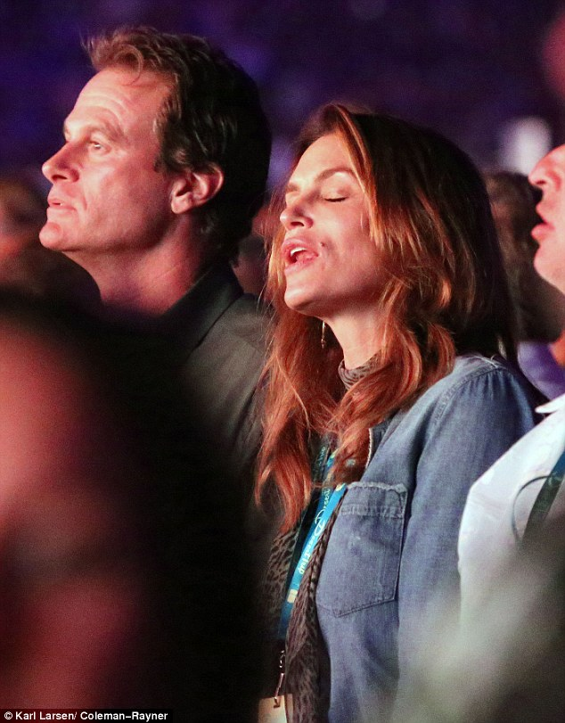 She knows all the wordsL The 50-year-old former supermodel closed her eyes and sang as she stood next to her husband of 18 years