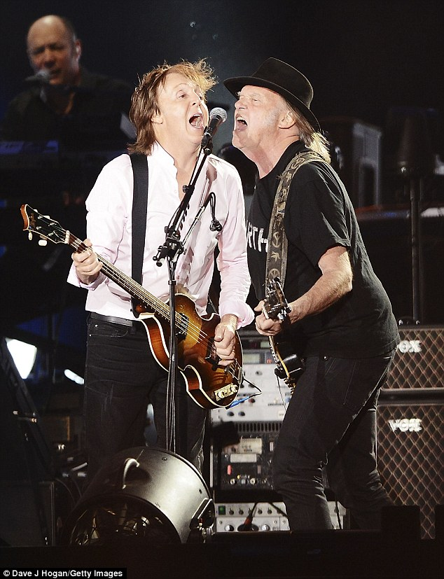 Guitar heroes: Neil Young played before McCartney and joined him on stage for a few numbers