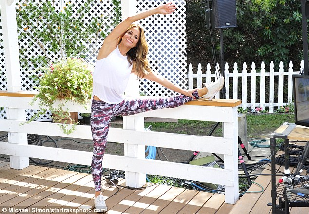 Getting ready:She kicked off her workout with some stretches before getting started on her workout on her mat