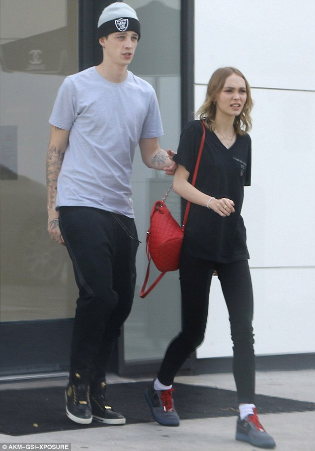 Rumour mill: Lily-Rose has been linked to Ash Stymest, who she is pictured with here in June