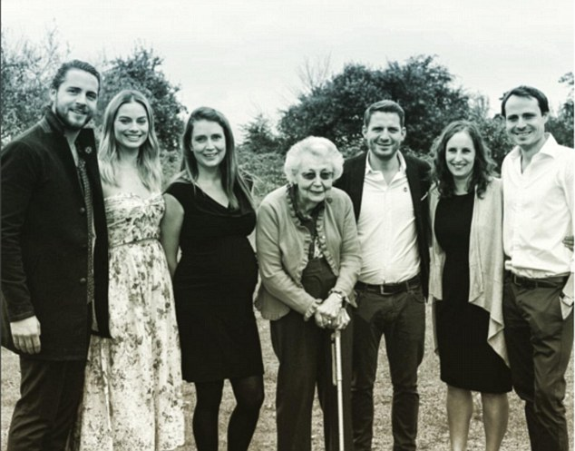 Bonding with the in-laws! Margot Robbie looked like one of the family when she attended the wedding of Tom's brother Ben Ackerley in August