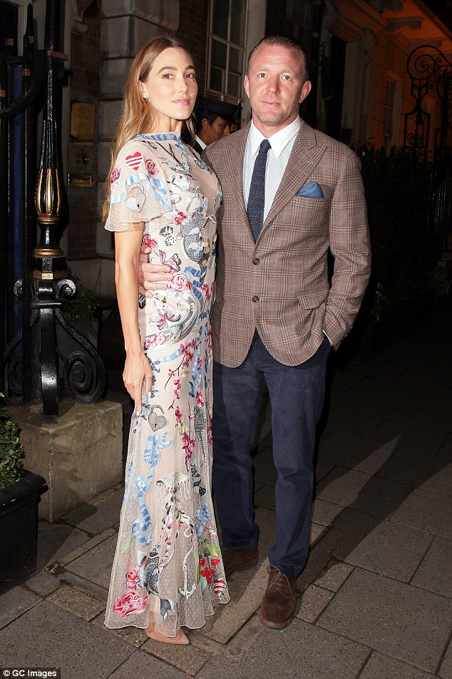 Man about town: The dapper director poses with his gorgeous wife Jacqui Ritchie, 34