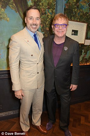 Sir Elton John (pictured with husband David Furnish) is going to spill the beans about his private life in a long-awaited autobiography
