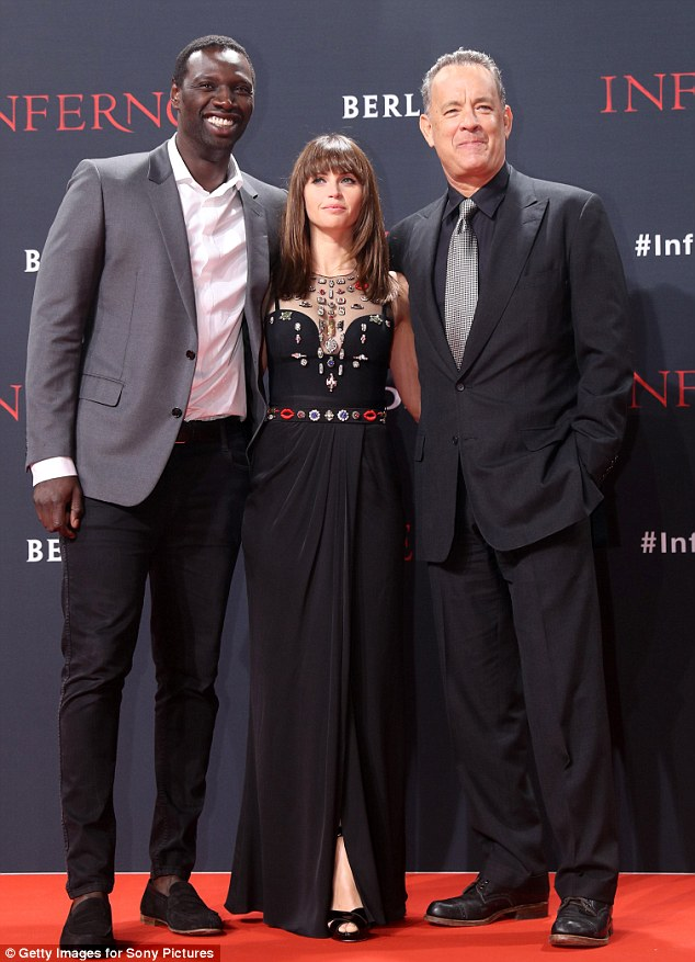 Three's a cool crowd: Omar Sy, Felicity Jones and Tom Hanks attend the German premiere