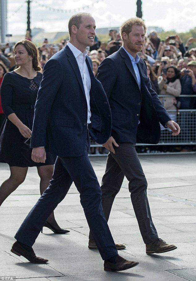 Natasha Archer, style adviser to his wife, is said to have helped to modernise his wardrobe. Pictured: William sporting his new look today with brother Prince Harry