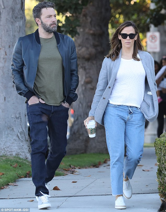 Family man: Ben was back in LA in time for the school run after promoting The Accountant in New York City