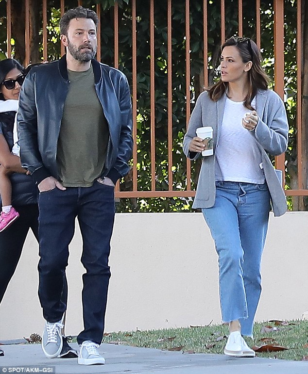 Dressed down:The Miracles From Heaven star was dressed casually in a white T-shirt and slip-on shoes with jeans and a grey jacket