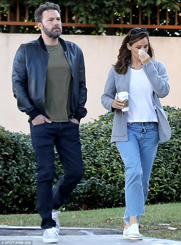 Simple style:Meanwhile Ben wore a black leather jacket over an olive green T-shirt, dark jeans and grey trainers