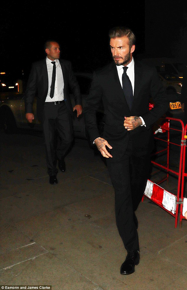 Suited and booted:David looked typically dapper in a smart black suit and tie for his event