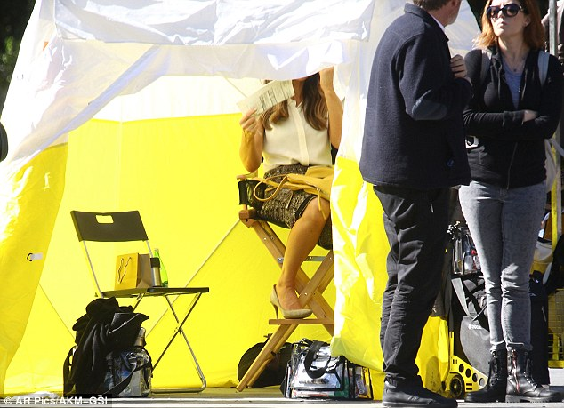 Taking cover: Kate was seen taking shade inside a luminous tent