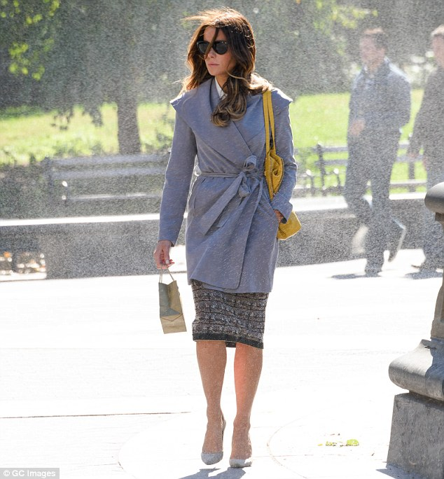Classy: The British beauty looked elegant in a knee-length skirt teamed with pale high-heels