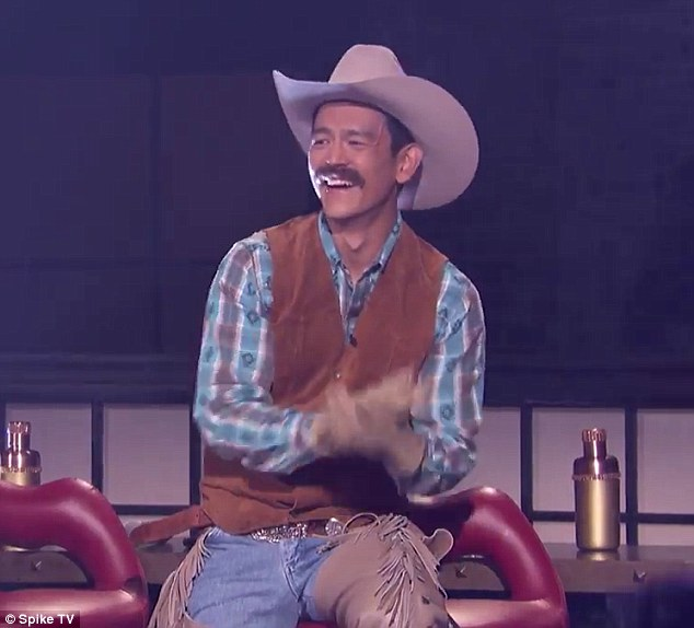 That's one bad hat: His Lip Sync opponent John Cho, who was dressed as a cowboy, could only marvel - and laugh - as he stood on the side clapping
