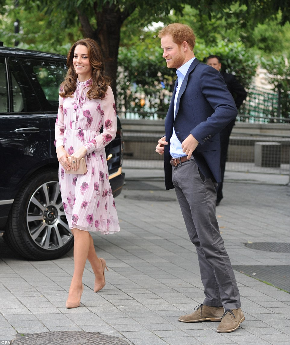 Fun-loving Prince Harry grinned as he arrived at County Hall with his sister-in-law Kate this morning
