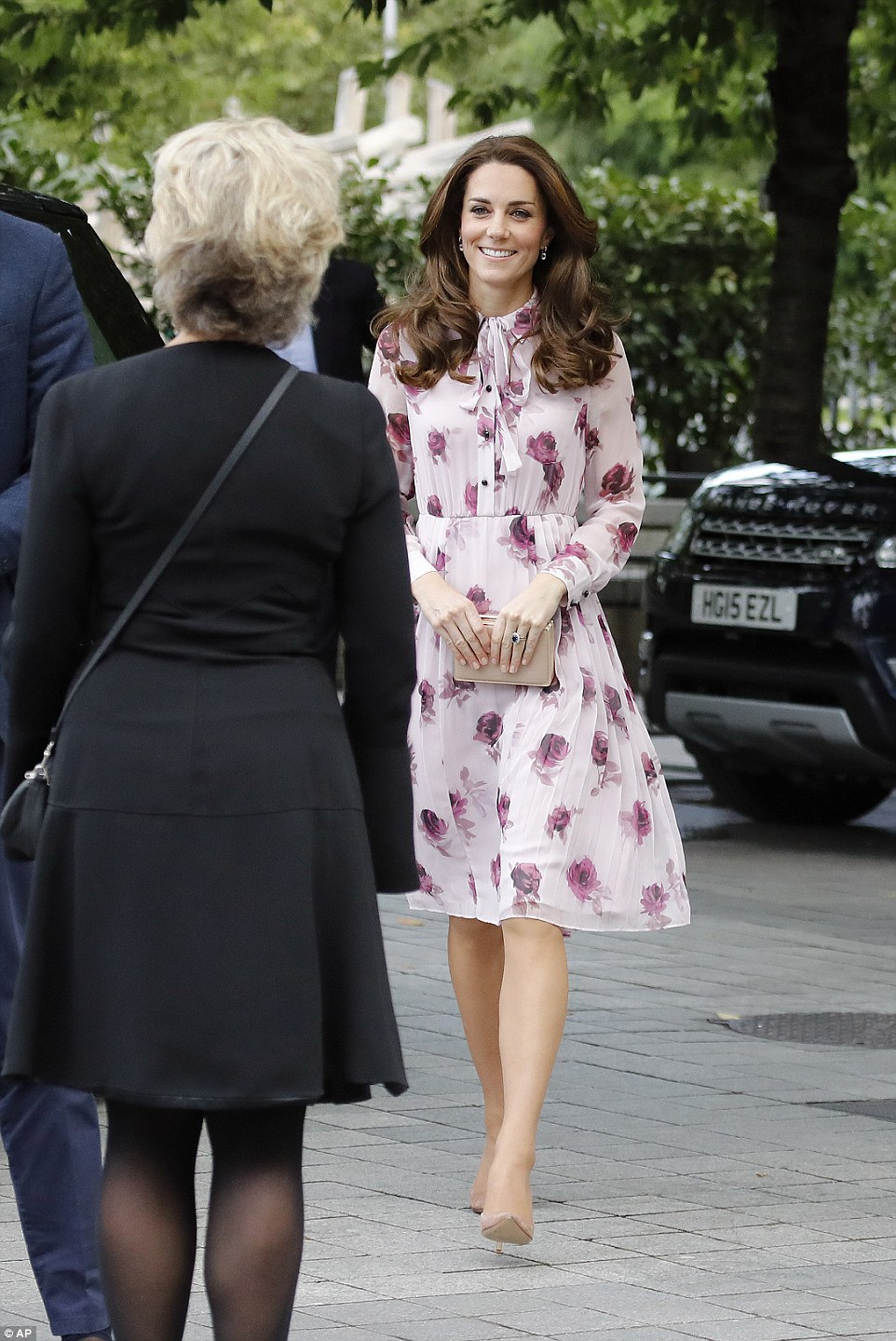 The Duchess's dress by Kate Spade New York features a pussy bow feature and light pleating