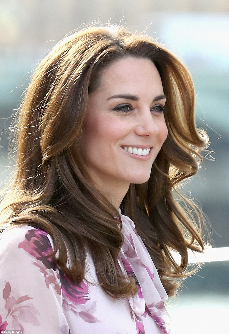 Kate flashes her pearly whites as she greets the crowd with a warm smile