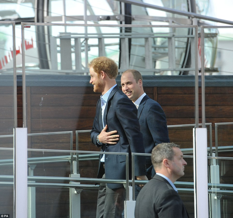 Princes William and Harry share a joke as they prepare to board the London Eye