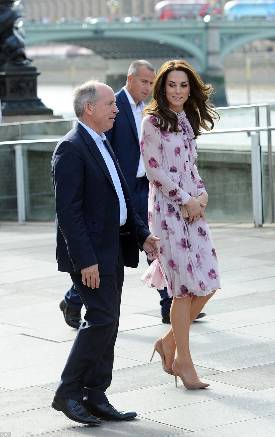 The Duchess of Cambridge walks from County Hall on the Southbank in London, to the Coca Cola London Eye after chatting to people who have battled with psychological problems