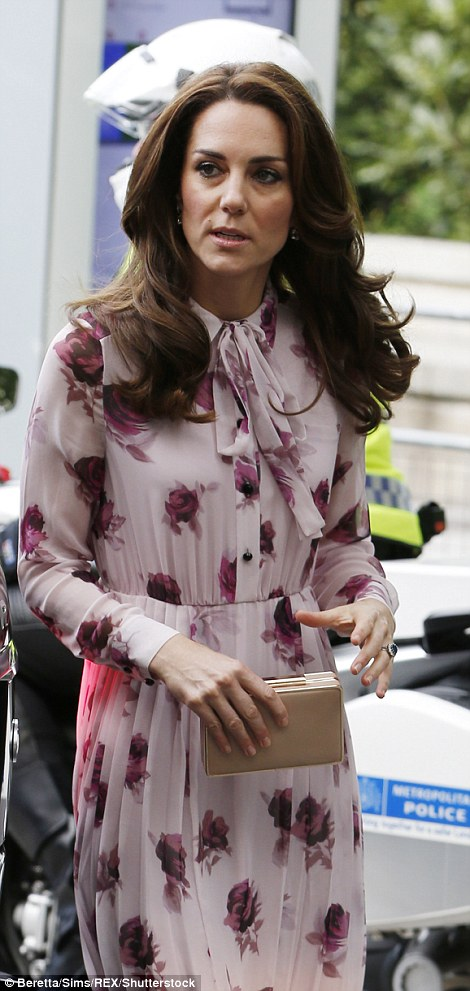 Kate's brunette locks were looking especially voluminous this morning on an engagement in London