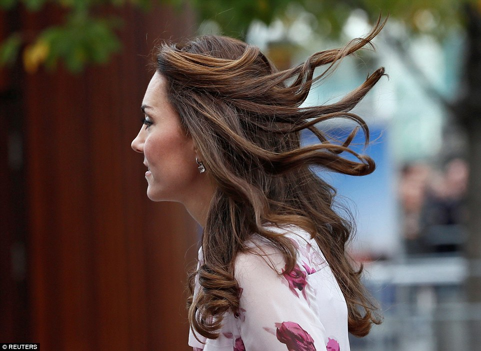 Kate's signature bouncy blow dry got caught up in the wind as she made her way into County Hall