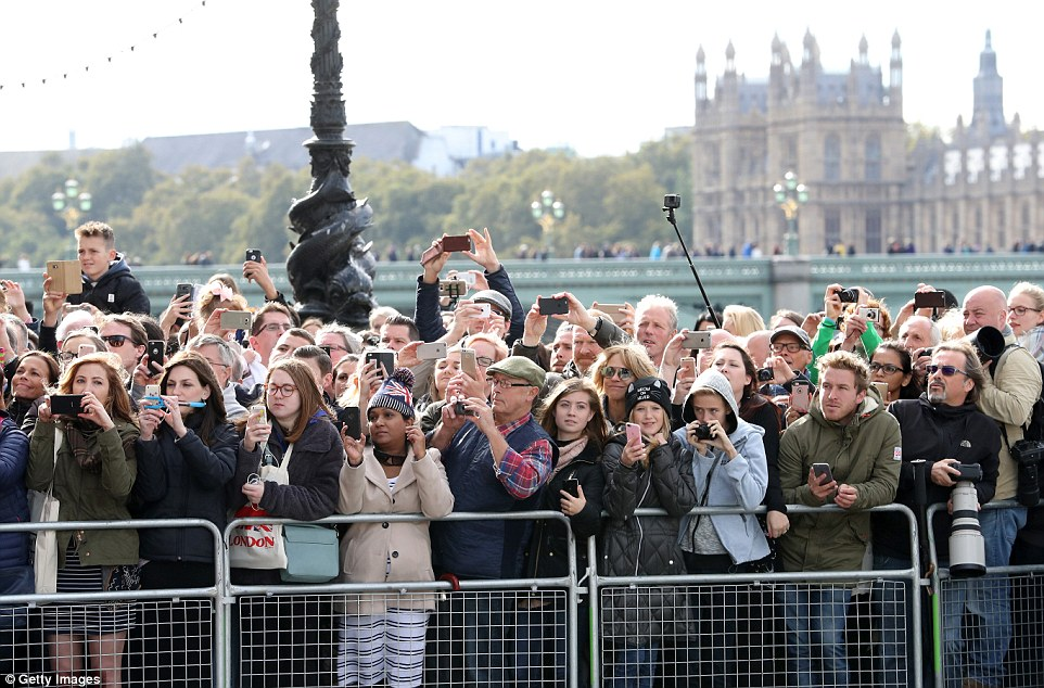 Members of the public await Prince William, Kate and Prince Harry ahead of the World Mental Health Day celebration with Heads Together at the London Eye